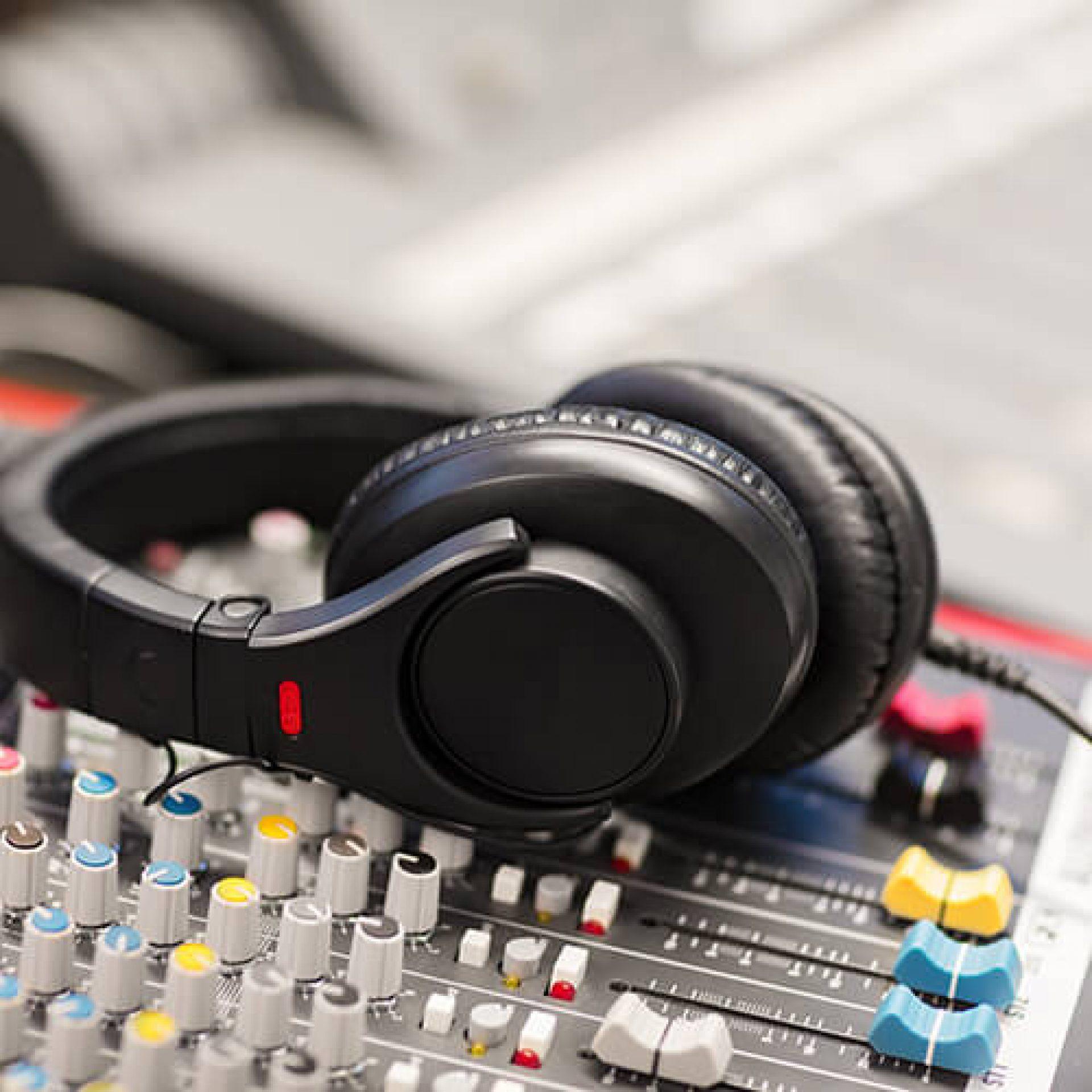 headphones-on-sound-mixer-in-professional-radio-st-PCZDYHM
